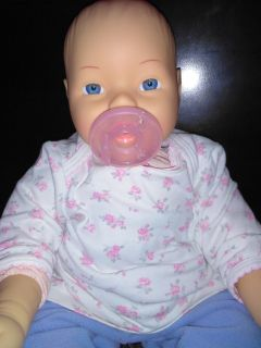 Baby girl doll with pink cloth body
