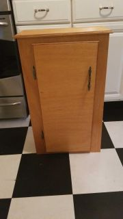 Tall cabinet with shelving