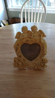 """Antique looking heart shaped photo frame with angels measures 8"""" by 7"""""""