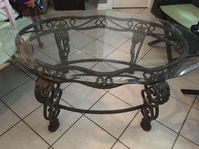 Ornate iron and glass top coffee table in excellent used condition