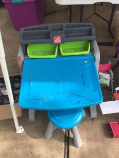 Toddler activity desk with tool