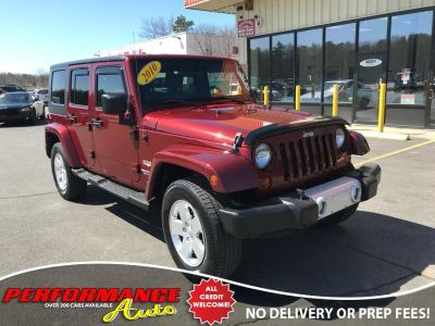 2010 Jeep Wrangler Unlimited Sahara (Red Rock Crystal Pearl)