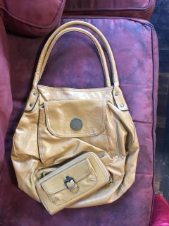 Awesome hobo style Axcess brand bag and wallet set. Perfect color for fall. Great cond.