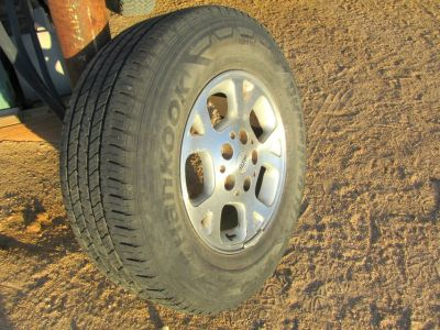 4 - 245x16 tires and rims