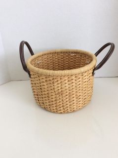 Basket with faux leather handles