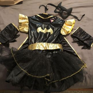 Batgirl costume size small (4-6) would fit a 3 or 4 year old