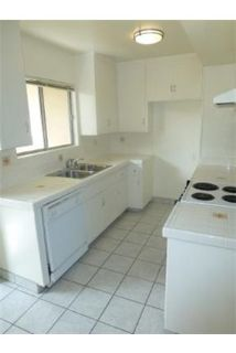2 bedrooms Apartment - 2nd floor unit with laminate wood floors and tile.