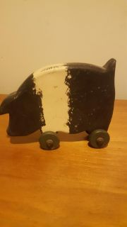 Wooden pig on wheels