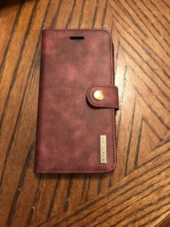 This is a brown iphone 6s plus leather card holder wallet cases