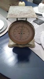 Vintage metal scale. Has a wicker basket too. Firm