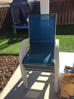 4 blue outdoor patio chairs