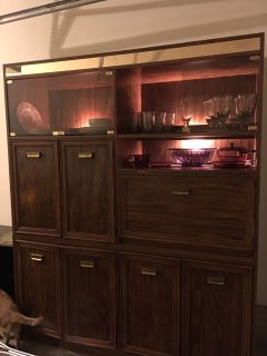 Cabinet with lights and kitchen stuff