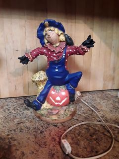 Vintage Halloween ceramic scarecrow and light up Jack o lantern has a orange bulb in it . On and off switch
