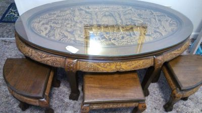 Antique oriental handcarved table with 6 fitted stools