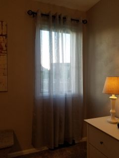 Two sets of two panels of gray grommet curtains. Like new condition.