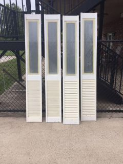 Bifold wooden doors with glass inserts