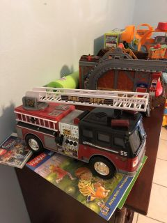 Sound and light up fire truck.