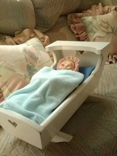 Porcelain Doll in Cradle