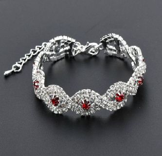 A Striking Silver Tennis Bracelet with Red Austrian Crystal Stones
