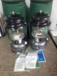 2 Coleman dual fuel lanterns and cases
