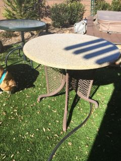 Patio table with marble top