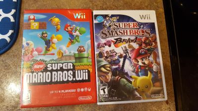 EUC wii games Super smash Brothers brawl and super Mario Brothers
