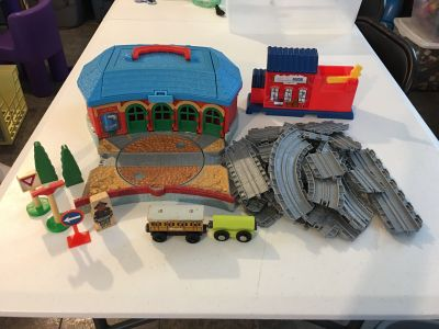 Thomas the Train Train set with station and accessories Top & doors open on station for storageTrains attach with magnetic ends