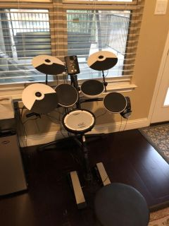 Roland v-drums with headset and amplifier