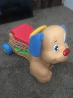 Fisher price Ride on and push dog
