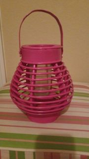 Pink wooden candle holder