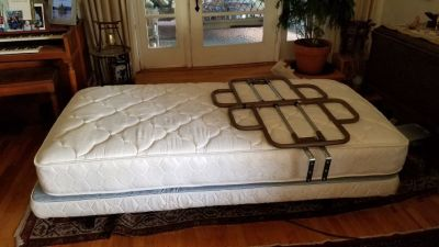 Adjustable electric bed with railings