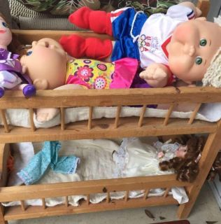 Dolls with wooden bunk bed