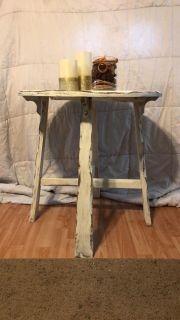 Distressed circular table great for weddings or homes!