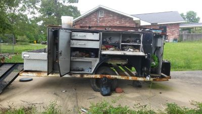 Fully enclosed utility bed on trailer