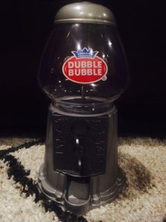 New never used! medium size 11 metal and glass candy gumball machine, silver color.