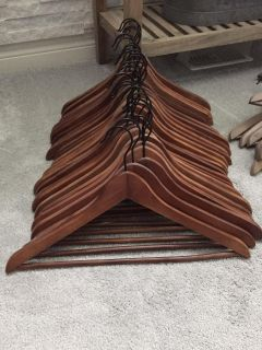 29 wooden hangers EUC $15 for the lot