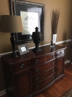Stunning solid mahogany buffet. Excellent condition with a few minor scratches on top.
