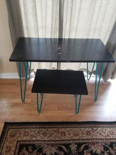 Desk or vanity with matching stool.