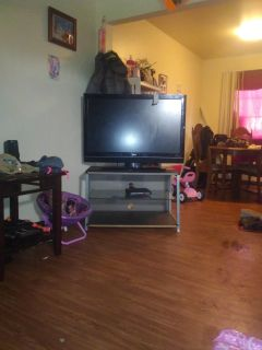 Lg flat screen TV and TV stand