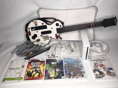 Wii bundle with Wii Fit, Guitar Hero, 2 remotes, 2 nunchucks 5 games Mario Kart