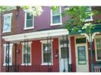 Real Estate For Sale - Four BR, One BA Townhouse