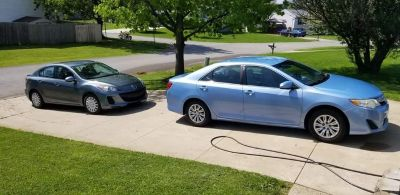 2014 toyota camry LE listed below blue book