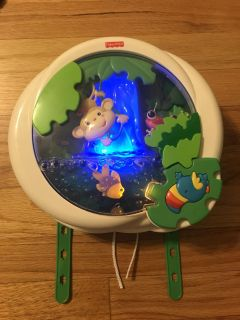 Fisher-Price rainforest crib soother- music toy