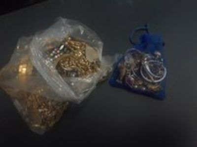 small bag of earrings and much more