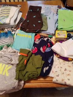 Bundle of Baby Boy clothes . From 18 months till 9 . 2 blankets. 1 burp pad. All in great condition. All for $10