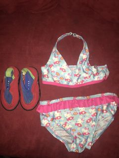 Girls size 4 bathing suit and size 4 water shoes