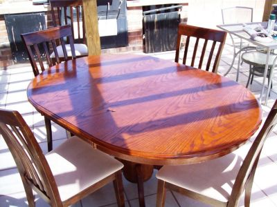 Solid Wooden Dining Table With Four Matching Chairs
