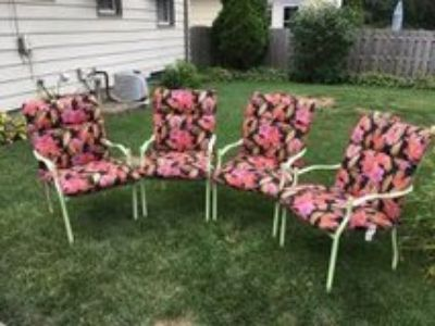 4 wrought iron patio chairs/new cushions