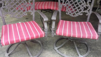 Two Patio chair cushions and one bench cushion