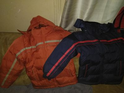 Two brand new coats for boy ( size small)